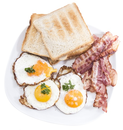 Fried Eggs and Bacon isolated on white background photo