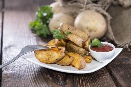 potato wedges: Portion of fresh homemade Potato Wedges