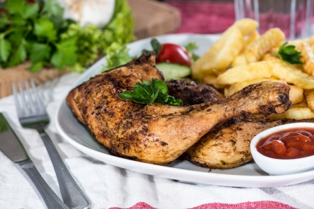 Portion of grilled Chicken Legs with Chips photo