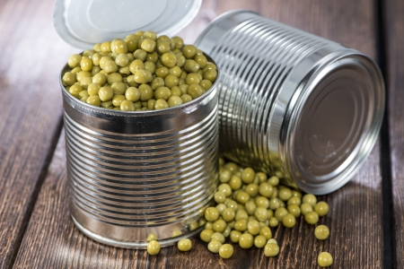 canned peas: Can with Peas on vintage wooden background Stock Photo