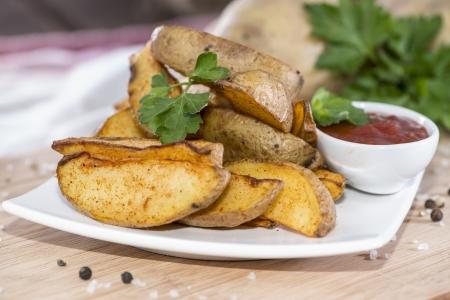 potato wedges: Fresh homemade Potato Wedges with parsley