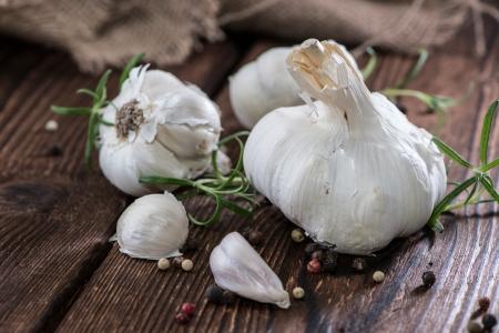 Dried Garlic on wooden background photo