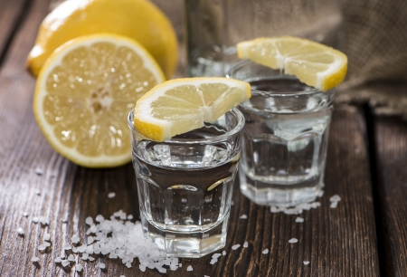Two Shots (Tequila) on vintage wooden background photo