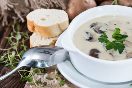 Creamy Mushroom Soup with fresh herbs photo