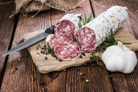 Portion of Salami Slices with fresh Herbs and Garlic photo
