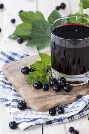 Fresh Black Currant juice with some fruits Stock Photo