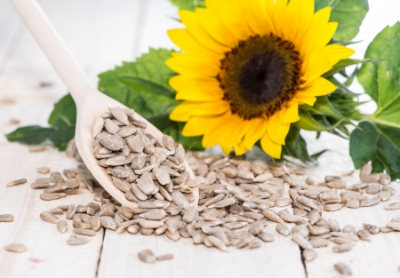 sunflower seeds: Fresh Sunflower Seeds (Macro Shot on wooden background) Stock Photo