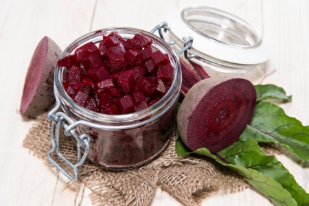Pickled Beetroot on wooden background photo
