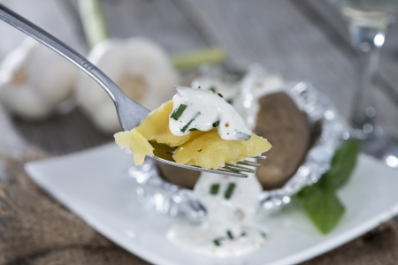 Piece of Baked Potatoe on a Fork Stock Photo - 21808606