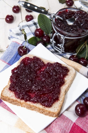 jam sandwich: Fresh made Cherry Jam Sandwich on a plate with fresh fruits