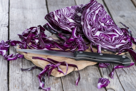 Fresh Coleslaw on wooden background photo