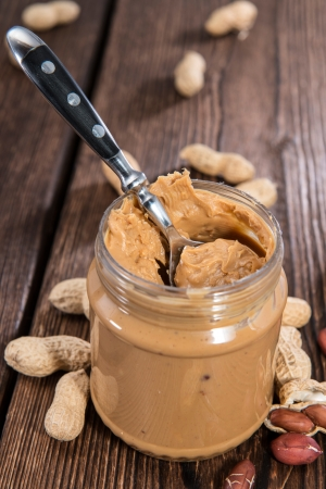 Fresh made creamy Peanut Butter in a glass photo