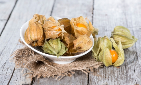 Some Physalis Fruits on vintage wooden background photo