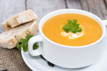 Portion of fresh made Pumpkin Creme Soup Stock Photo
