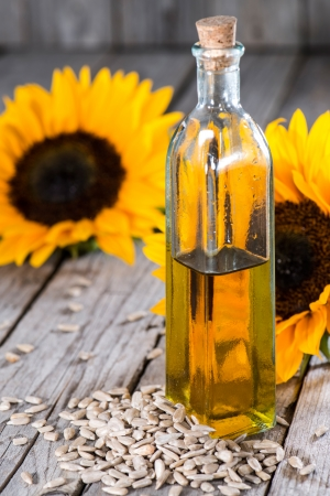 Fresh Sunflower Oil on wooden background Stock Photo - 22355298