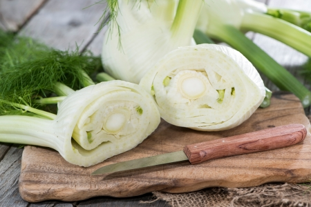 fennel: Some pieces of fresh Fennel on wood