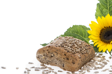Bun with Sunflower Seeds isolated on white background photo