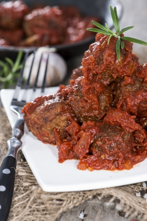 Meatballs with Tomato Sauce and herbs on a small plate photo
