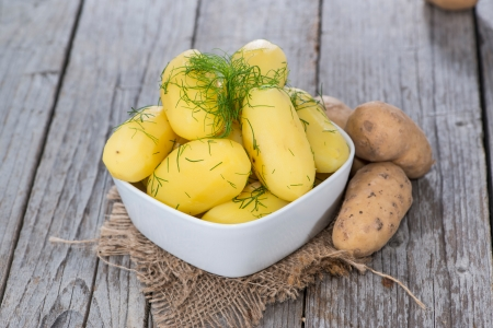Portion of boiled Potatoes with freh herbs photo