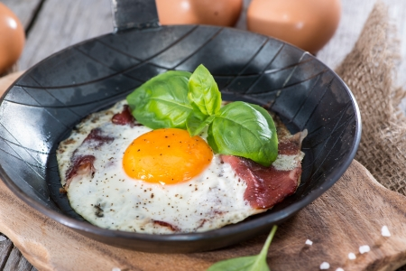 Fried Egg with Bacon in a small Pan photo