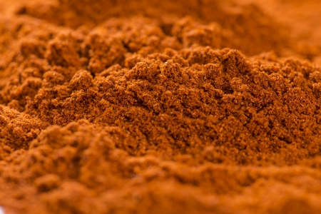 Paprika Powder background (Macro Shot) photo
