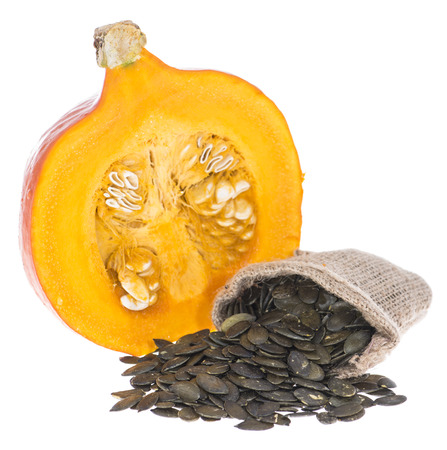Portion of isolated Pumpkin Seeds (on white background) photo