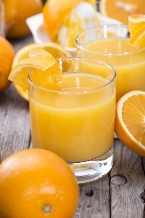 Fresh made Orange Juice on wooden background  photo
