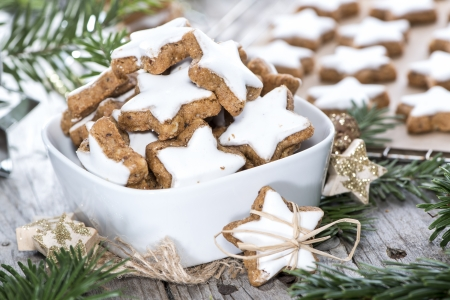 Fresh made Cinnamon Cookies on vintage christmas background Stock Photo - 23848996