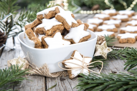 Fresh made Cinnamon Cookies on vintage christmas background photo