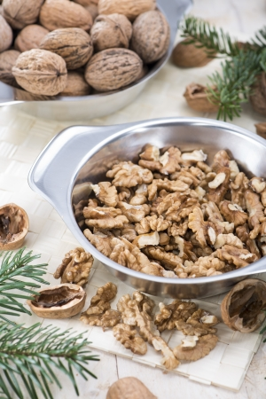 Fresh portion of Walnuts on brigth  photo
