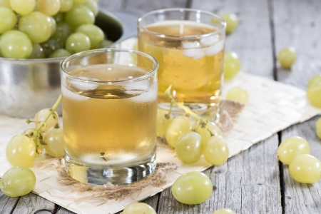and grape juice: Fresh made Grape Juice with fresh fruits in a glass Stock Photo