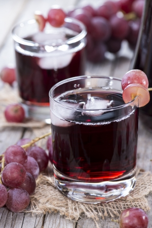 and grape juice: Chilled Red Grape Juice with fresh fruits Stock Photo