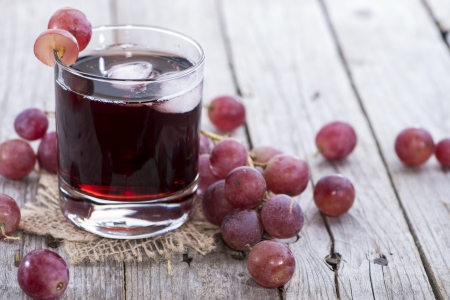 purple red grapes: Chilled Red Grape Juice with fresh fruits Stock Photo