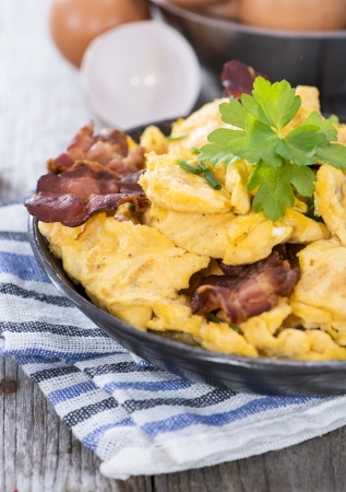 Scrambled Eggs with fresh eggs and herbs photo