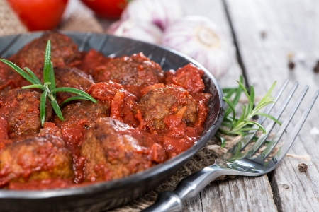 Fresh made Meatballs with Sauce in a vintage pan photo