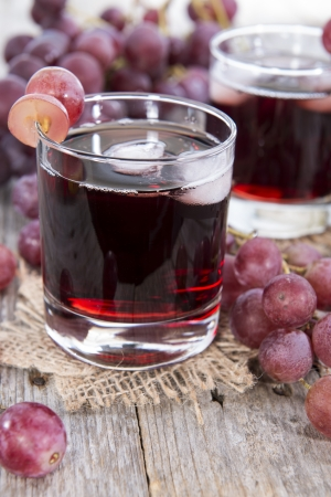 and grape juice: Grape Juice with Ice in a glass