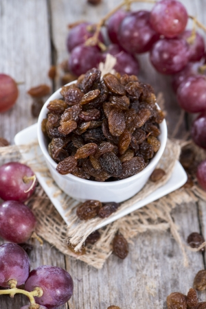 Heap of Raisins with fresh fruits Stock Photo