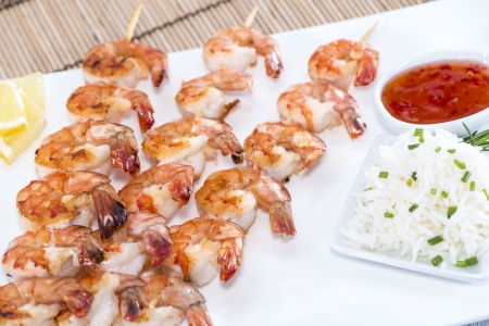 Skewered Tiger Prawns with a portion of fresh Rice photo