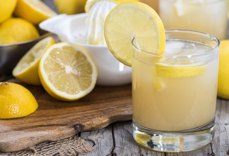 jus de citron: Glass filled with fresh made Lemon Juice