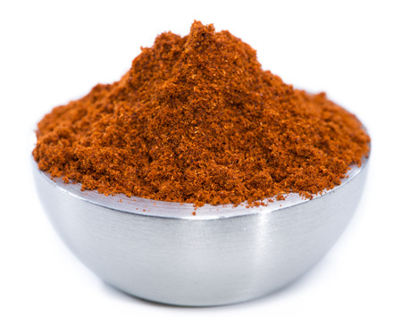 Bowl with Paprika Powder (isolated on white background) photo