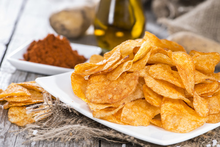 fatty food: Potato Chips with portion of sunfloweroil and paprika powder