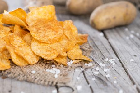 Heap of Paprika Potato Chips on rustic