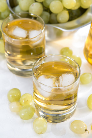 and grape juice: Grape Juice in a glass with fresh fruits Stock Photo