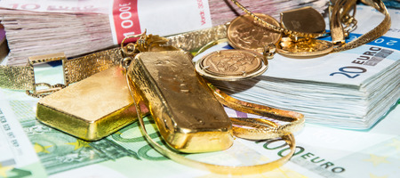 Euro bills and Gold (bullions and jewellery) photo