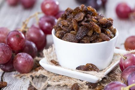 Heap of Raisins on vintage wooden background