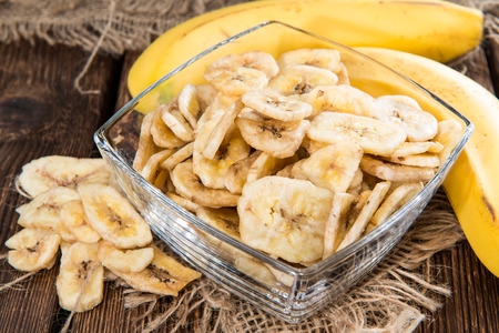candied fruits: Portion of fresh dried Banana Chips (healthy food)