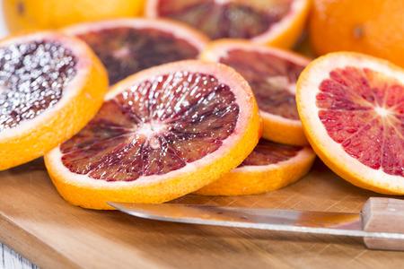 Fresh piece of juicy Blood Orange (close-up shot)