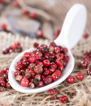 Portion of dried Pink Peppercorns (detailed close-up shot) photo
