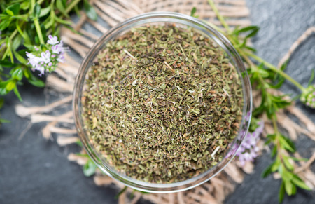 Portion of dried Winter Savory in a small bowl Stock Photo