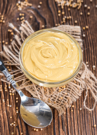 Portion of Mustard (on vintage wooden background) photo
